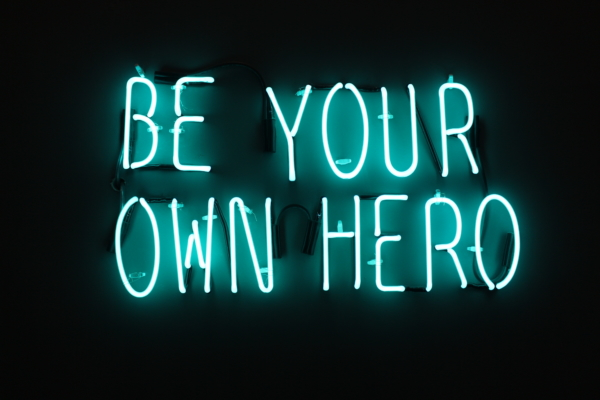 Be your own hero neon sign in gym